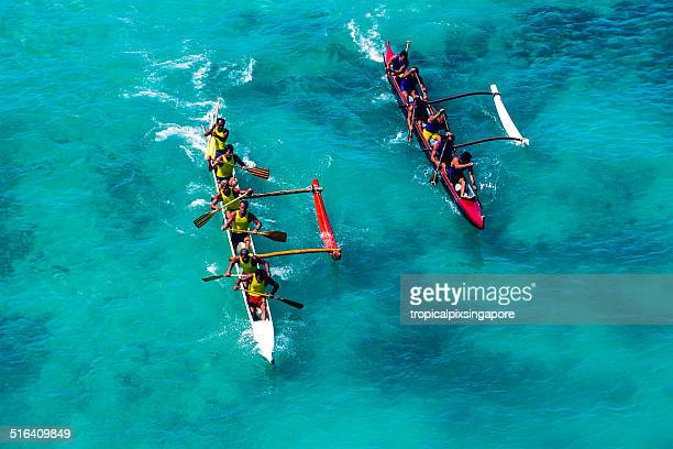 outrigger canoe racing at waikiki beach - paddling stock pictures, royalty-free photos & images