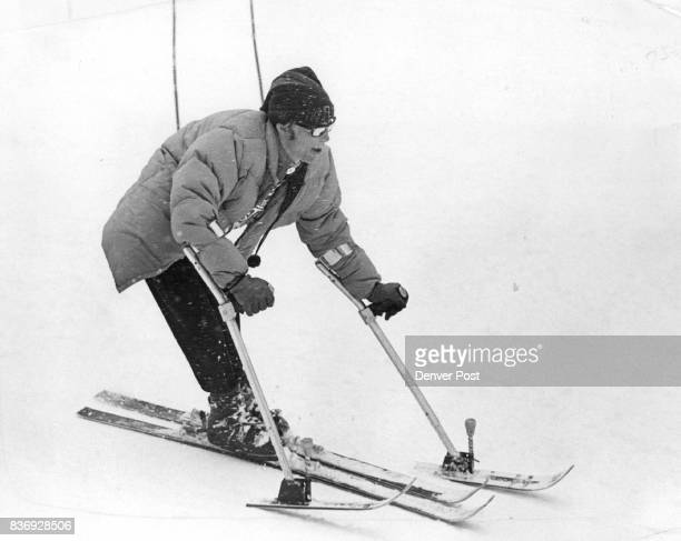 Outrigger Poles Do The Trick David Trexler of American Fork Utah a double amputee uses his 'outrigger' ski poles to maintain balance as he makes run...