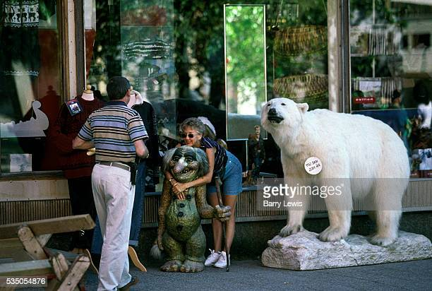 Outside a shop in Tromso with large polar bear statue. For more than a century, the coastal steamer Hurtigruten has been the lifeline linking the...