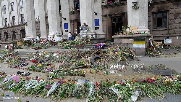 Outside a Trade Union headquarters in Odessa, Ukraine, floral tributes commemorate the May 2 deaths of 42 pro-Rusisians in the building, which was...