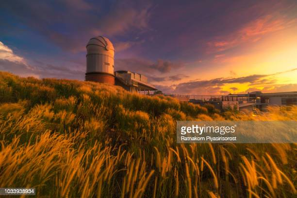 outside astronomical observatory telescope tower in sunrise scene - solar physics observatory stock pictures, royalty-free photos & images