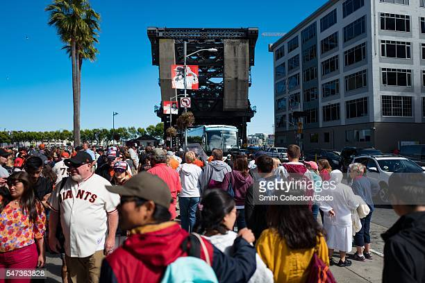 Outside ATT Park baseball stadium in the China Basin neighborhood of San Francisco, California, fans of the San Francisco Giants baseball team gather...
