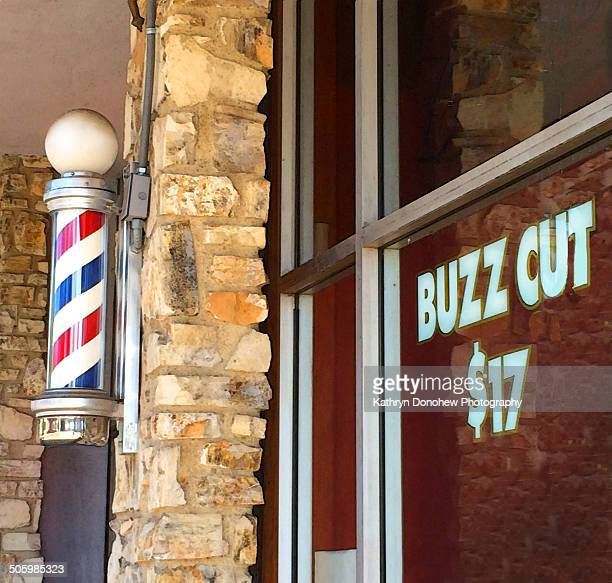 Outside barbershop Sign advertising hair cut Barber pole