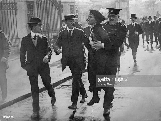 Outside Buckingham Palace English suffragette Emmeline Pankhurst is arrested and carried away by Superintendent Rolfe at a march organised by...