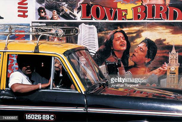 Outside Churchgate station in Mumbai, the walls are covered with promotional advertisements for Bollywood films January 1997 in Mumbai, India.
