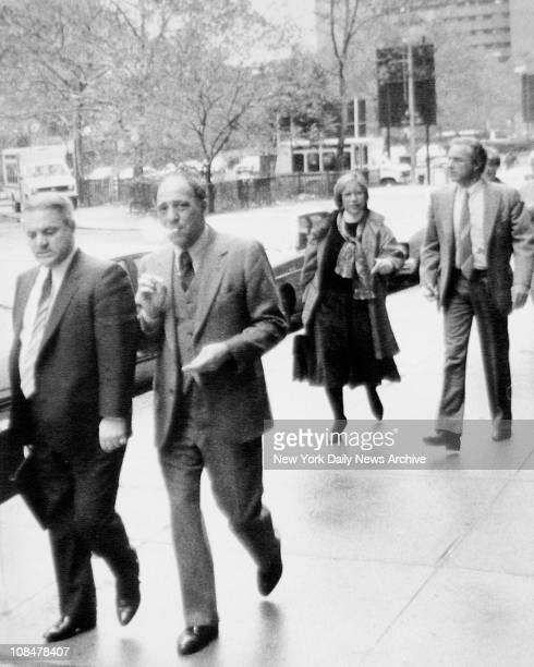 Outside court defendants John DeRoss and Andrew Russo stroll in front of actor actor James Caan a friend of Russo and an unidentified woman who is...
