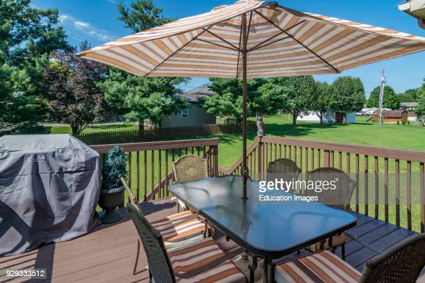 Outside deck chairs and table with umbrella