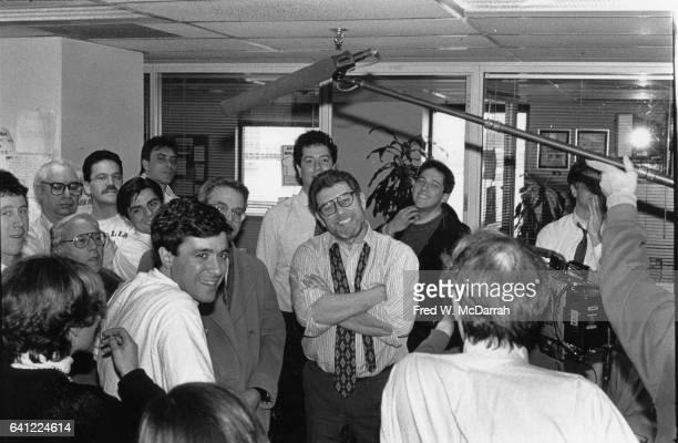 Outside his office in the New York Post's newsroom and surrounded by fellow reporters American journalist Pete Hamill is interviewed for a television...