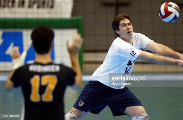 Outside hitter Jonathan Alleman of BYU bumps the ball against Long Beach State University during the Division I Men's Volleyball Championship held at...