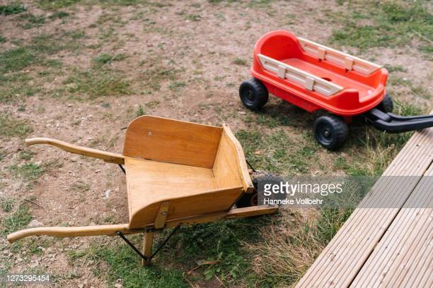 outside kids wheelbarrow toys - kamperen stock pictures, royalty-free photos & images