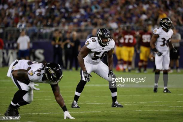 Outside linebacker Albert McClellan of the Baltimore Ravens lines up a Washington Redskins during a preseason game at MT Bank Stadium on August 10...