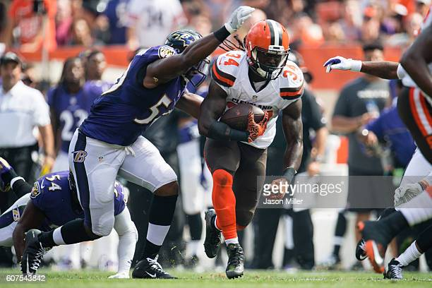 Outside linebacker Albert McClellan of the Baltimore Ravens tackles running back Isaiah Crowell of the Cleveland Browns during the first quarter at...