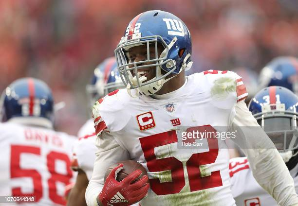 Outside linebacker Alec Ogletree of the New York Giants reacts after an interception in the second quarter against the Washington Redskins at...