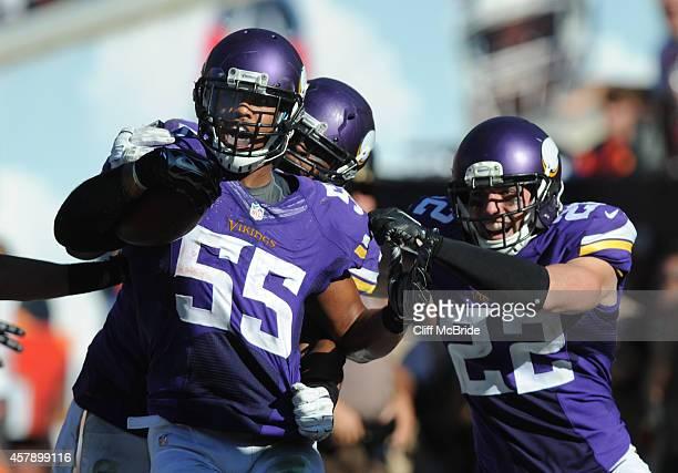 Outside linebacker Anthony Barr of the Minnesota Vikings celebrates with free safety Harrison Smith of the Minnesota Vikings after a fumble recovery...