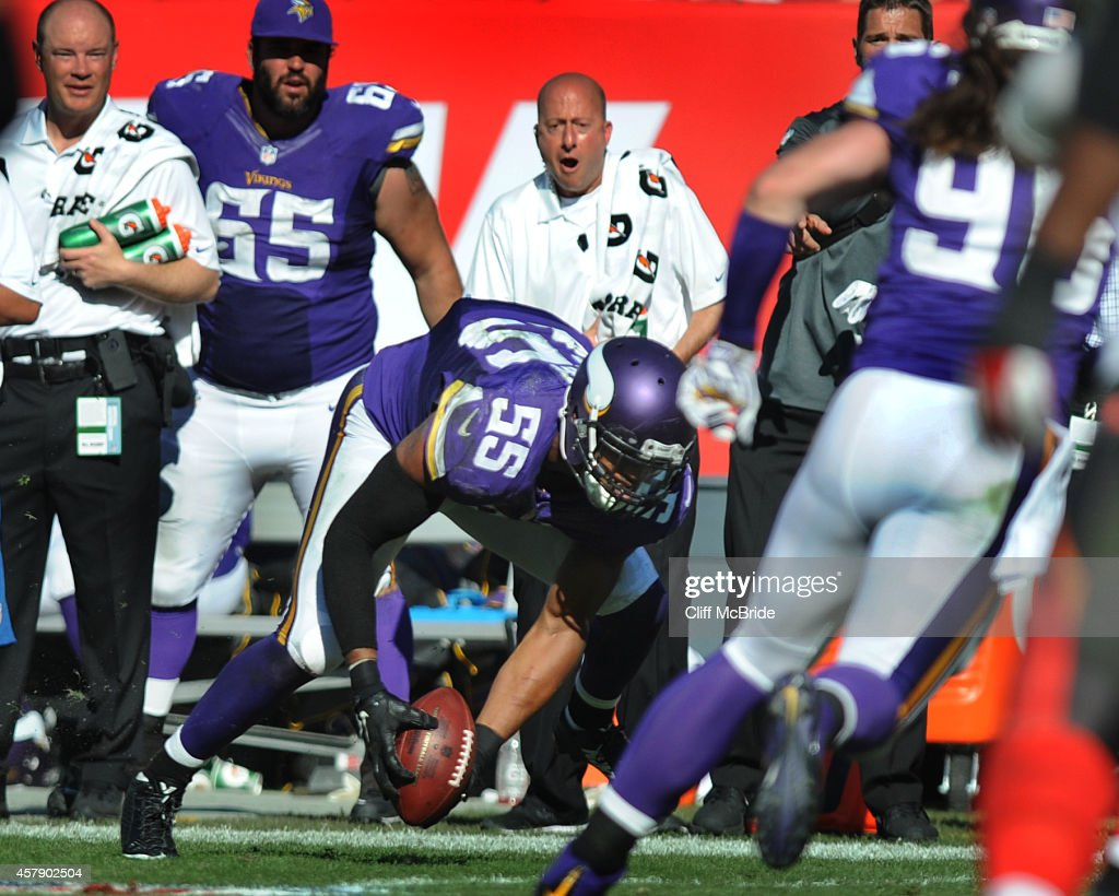 Outside linebacker Anthony Barr #55 of the Minnesota Vikings recovers the ball fumbled by tight end Austin Seferian-Jenkins #87 of the Tampa Bay Buccaneers at Raymond James Stadium on October 26, 2014 in Tampa, Florida. Barr ran the ball for a touchdown to win the game in overtime.