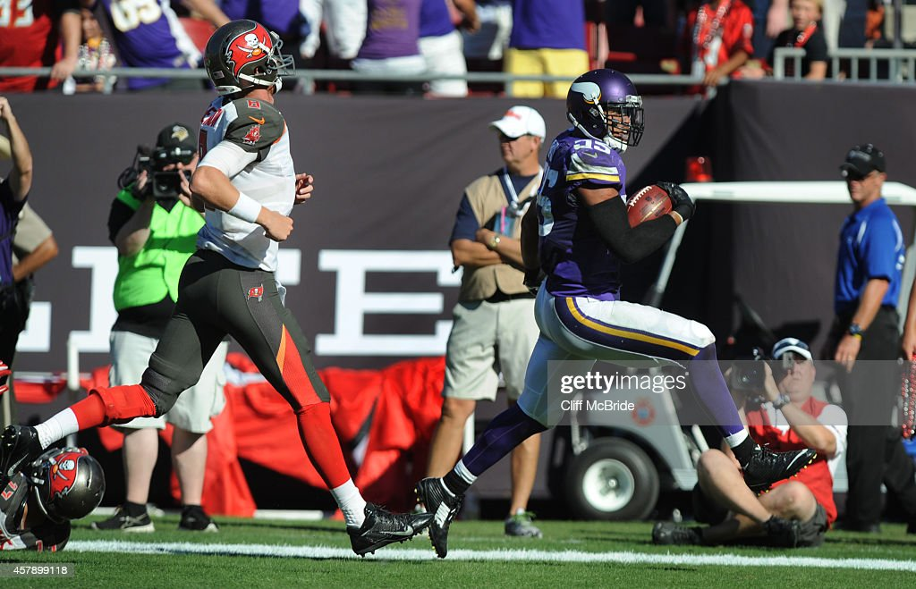 Outside linebacker Anthony Barr #55 of the Minnesota Vikings runs the ball into the endzone for the winning TD as quarterback Mike Glennon #8 of the Tampa Bay Buccaneers chases in overtime at Raymond James Stadium on October 26, 2014 in Tampa, Florida.