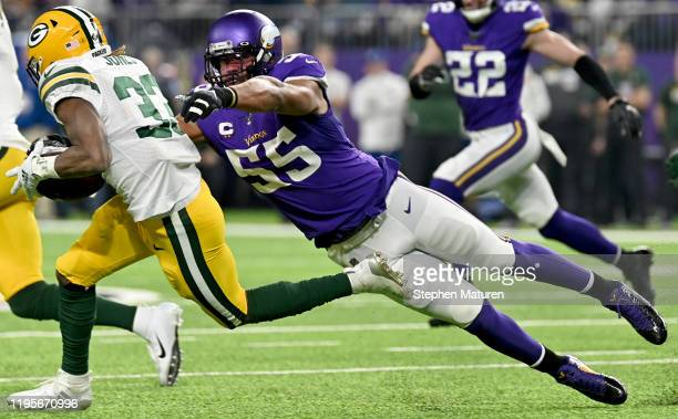 Outside linebacker Anthony Barr of the Minnesota Vikings tackles running back Aaron Jones of the Green Bay Packers to cause a fumble in the first...