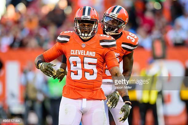 Outside linebacker Armonty Bryant and free safety Tashaun Gipson of the Cleveland Browns celebrate after a play during the second half at FirstEnergy...