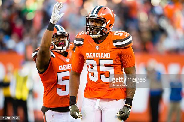 Outside linebacker Armonty Bryant and inside linebacker Craig Robertson of the Cleveland Browns celebrate after a play during the second half at...