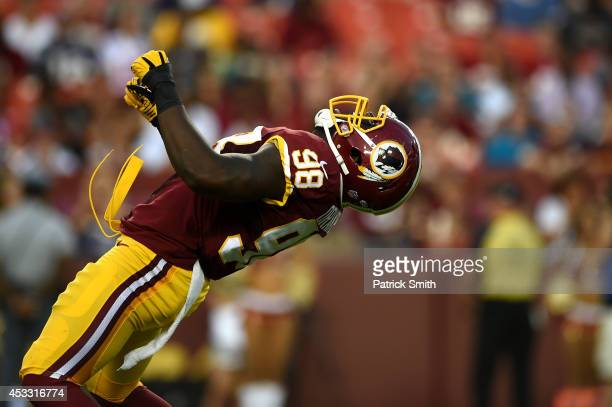 Outside linebacker Brian Orakpo of the Washington Redskins celebrates after sacking quarterback Ryan Mallett of the New England Patriots in the first...