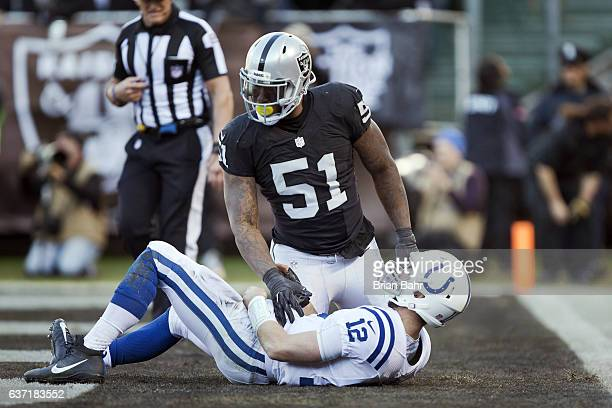 Outside linebacker Bruce Irvin of the Oakland Raiders puts quarterback Andrew Luck of the Indianapolis Colts flat on his back in the endzone at the...