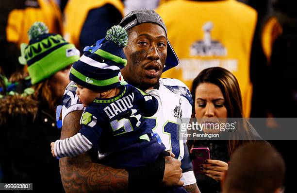 Outside linebacker Bruce Irvin of the Seattle Seahawks celebrates win his son after Super Bowl XLVIII at MetLife Stadium on February 2 2014 in East...