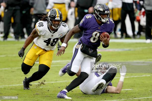 Outside linebacker Bud Dupree of the Pittsburgh Steelers chases quarterback Lamar Jackson of the Baltimore Ravens in the first quarter at M&T Bank...
