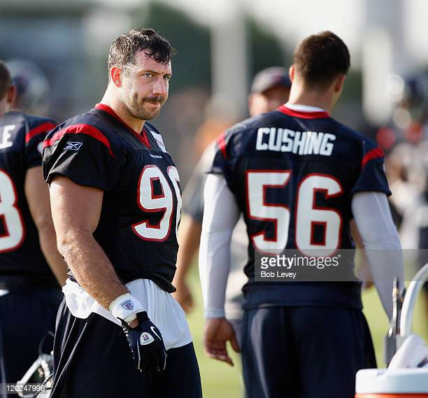 Outside linebacker Connor Barwin and inside linebacker Brian Cushing of the Houston Texans during practice on the first day of training camp at...