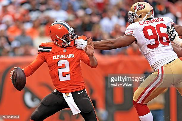Outside linebacker Corey Lemonier of the San Francisco 49ers grabs the face mask of quarterback Johnny Manziel of the Cleveland Browns during the...