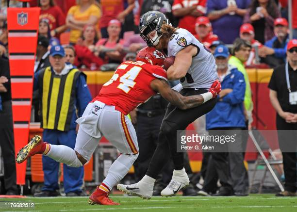 Outside linebacker Damien Wilson of the Kansas City Chiefs hits tight end Hayden Hurst of the Baltimore Ravens during the first half at Arrowhead...