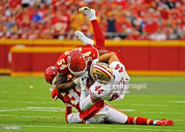 Outside linebacker Damien Wilson of the Kansas City Chiefs tackles fullback Kyle Juszczyk of the San Francisco 49ers during the first half of a...
