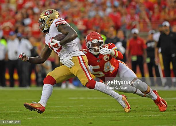 Outside linebacker Damien Wilson of the Kansas City Chiefs tackles wide receiver Deebo Samuel of the San Francisco 49ers during the first half of a...
