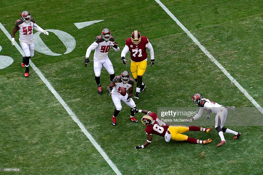 Outside linebacker Danny Lansanah #51 of the Tampa Bay Buccaneers makes a first quarter interception against the Washington Redskins at FedExField on November 16, 2014 in Landover, Maryland.