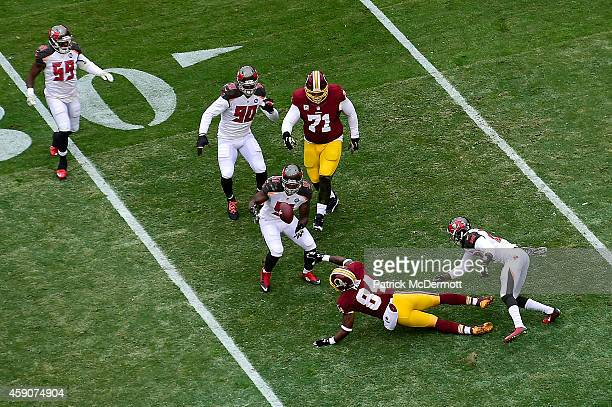 Outside linebacker Danny Lansanah of the Tampa Bay Buccaneers makes a first quarter interception against the Washington Redskins at FedExField on...