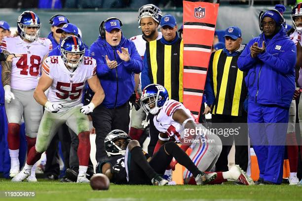 Outside linebacker David Mayo of the New York Giants reacts from the sidelines to an incomplete pass broken up by cornerback Deandre Baker during the...