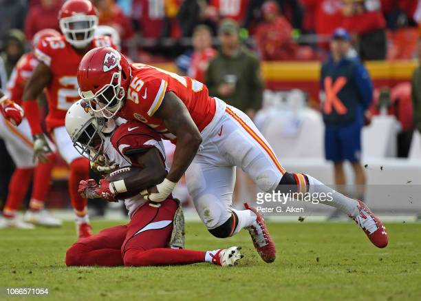 Outside linebacker Dee Ford of the Kansas City Chiefs tackles wide receiver JJ Nelson of the Arizona Cardinals for a loss during the second half on...