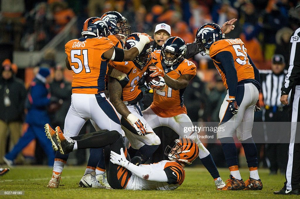 Outside linebacker DeMarcus Ware #94 of the Denver Broncos comes up with the football after recovering a fumble by quarterback AJ McCarron #5 of the Cincinnati Bengals to end the game in overtime at Sports Authority Field at Mile High on December 28, 2015 in Denver, Colorado. The Broncos defeated the Bengals 20-17.