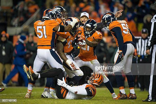 Outside linebacker DeMarcus Ware of the Denver Broncos comes up with the football after recovering a fumble by quarterback AJ McCarron of the...