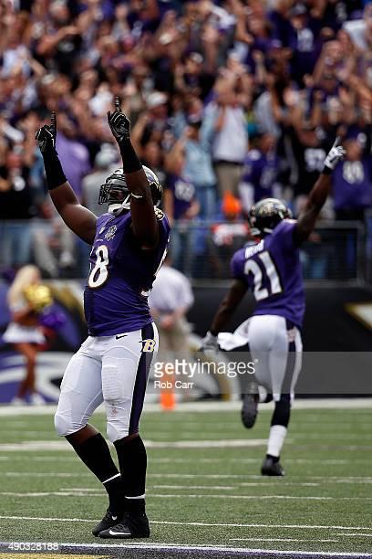 Outside linebacker Elvis Dumervil of the Baltimore Ravens celebrates with cornerback Lardarius Webb of the Baltimore Ravens after he forces a fumble...