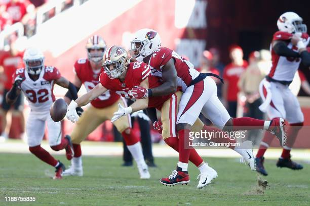 Outside linebacker Haason Reddick of the Arizona Cardinals breaks up a pass intended for tight end Ross Dwelley of the San Francisco 49ers in the...
