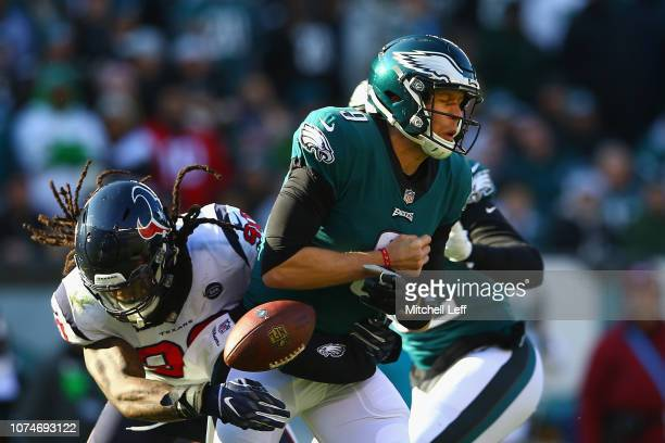 Outside linebacker Jadeveon Clowney of the Houston Texans forces a fumble on quarterback Nick Foles of the Philadelphia Eagles in the second quarter...