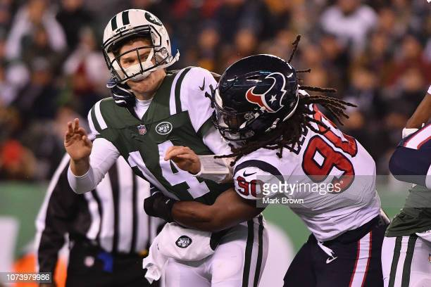 Outside linebacker Jadeveon Clowney of the Houston Texans hits quarterback Sam Darnold of the New York Jets during the second quarter at MetLife...