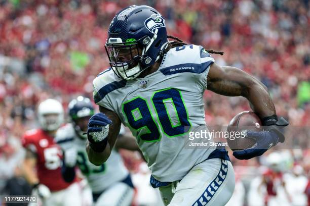 Outside linebacker Jadeveon Clowney of the Seattle Seahawks run in an interception for a touchdown in the first half of the NFL game against the...