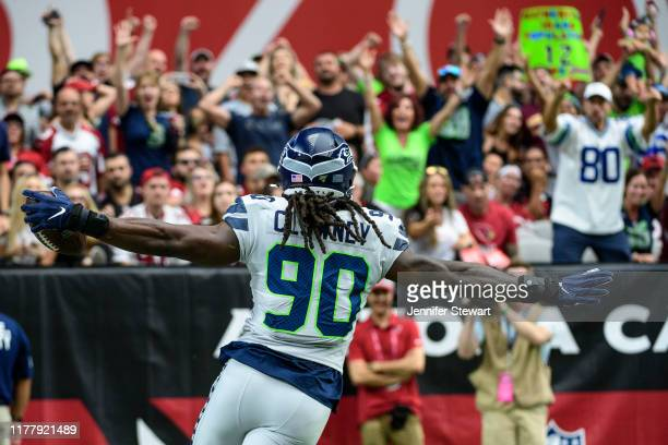 Outside linebacker Jadeveon Clowney of the Seattle Seahawks runs in an interception for a touchdown in the first half of the NFL game against the...