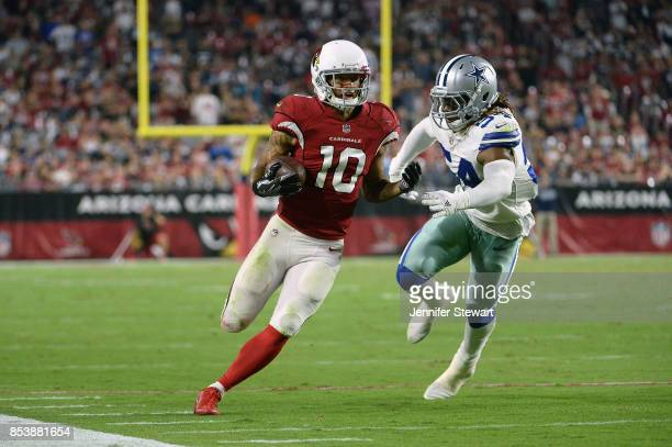 Outside linebacker Jaylon Smith of the Dallas Cowboys chases wide receiver Brittan Golden of the Arizona Cardinals during the second half of the NFL...