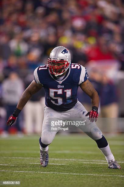 Outside linebacker Jerod Mayo of the New England Patriots defends during the AFC Divisional Playoff against the Houston Texans at Gillette Stadium on...