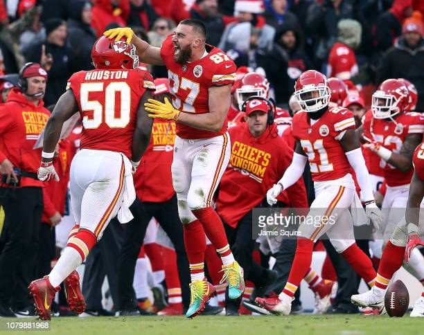 Outside linebacker Justin Houston of the Kansas City Chiefs is congratulated by tight end Travis Kelce after recovering a fumble late in the 4th...