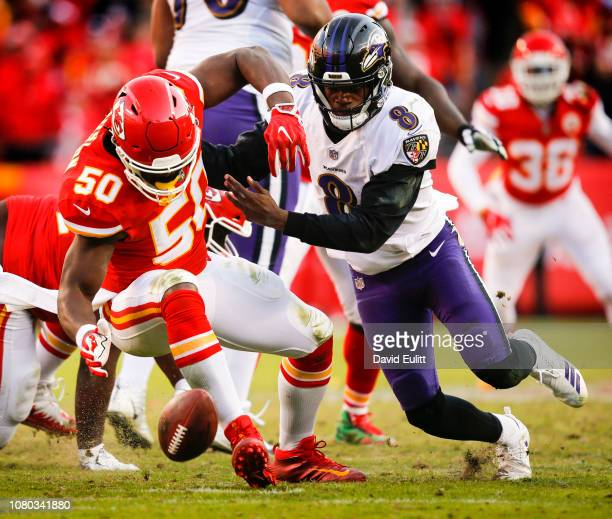 Outside linebacker Justin Houston of the Kansas City Chiefs reaches for the fumble caused by his strip sack of quarterback Lamar Jackson of the...
