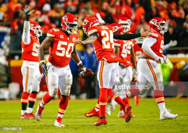 Outside linebacker Justin Houston of the Kansas City Chiefs receives congratulations from strong safety Jordan Lucas of the Kansas City Chiefs after...