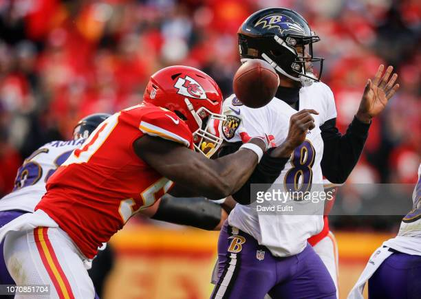 Outside linebacker Justin Houston of the Kansas City Chiefs strips the football from quarterback Lamar Jackson of the Baltimore Ravens late in the...